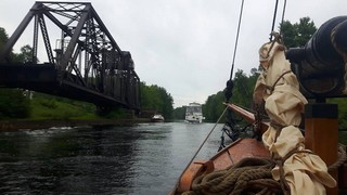 Sailing past the rail swing bridge with our fellow waterway transients